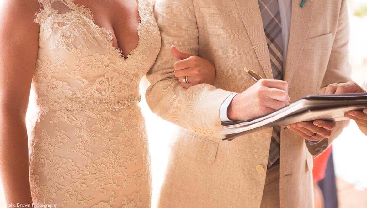 couple signing marriage license